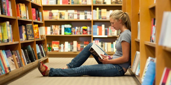 Girl sitting in bookstore